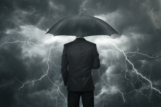 Business Man in storm